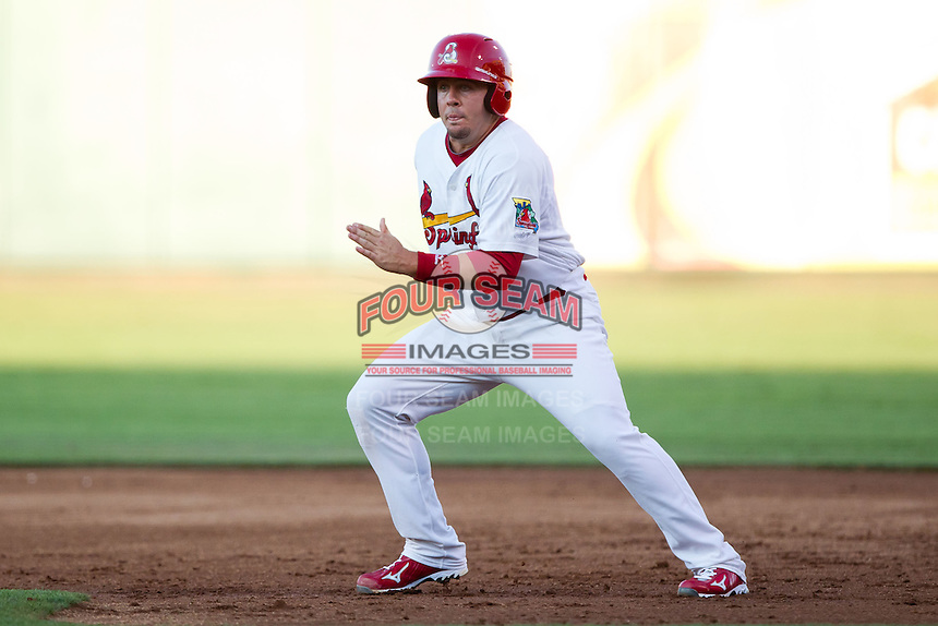 Zack Cox (7) of the Springfield Cardinals takes a lead off of first base during a game against the Tulsa Drillers at Hammons Field on July 18, 2011 in Springfield, Missouri. Tulsa defeated Springfield 13-8. (David Welker / Four Seam Images)