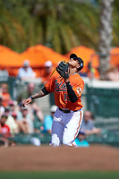 Baltimore Orioles third baseman Manny Machado (13) gets under a popup during a Spring Training game against the Minnesota Twins on March 7, 2016 at Ed Smith Stadium in Sarasota, Florida.  Minnesota defeated Baltimore 3-0.  (Mike Janes/Four Seam Images)