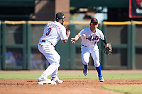 Scottsdale Scorpions second baseman Andres Gimenez (13), of the New York Mets organization, flips the ball to Alfredo Rodriguez (3), of the Cincinnati Reds organization, for an attempted double play during an Arizona Fall League game against the Surprise Saguaros at Scottsdale Stadium on October 26, 2018 in Scottsdale, Arizona. Surprise defeated Scottsdale 3-1. (Zachary Lucy/Four Seam Images)