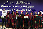Palestinian youths sing as Palestinian prime minister Salam Fayyad attends the opening ceremony during the inauguration of Yasser Arafat Building at Hebron University in the Palestinian city of Hebron in the West Bank on May 30, 2011.Photo by Najeh Hashlamoun
