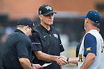 Wake Forest Demon Deacons head coach Tom Walter (16) shakes hands with West Virginia Mountaineers head coach Randy Mazey (14) prior to Game Six of the Winston-Salem Regional in the 2017 College World Series at David F. Couch Ballpark on June 4, 2017 in Winston-Salem, North Carolina.  The Demon Deacons defeated the Mountaineers 12-8.  (Brian Westerholt/Four Seam Images)