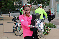 Amanda Dunne talks with former Missouri teammate and fellow Olympic hopeful in the triathlon Jill Peterson on the phone after running into Jill's fathers Jim, after the awards ceremony at the 2011 St. Louis Rock 'n' Roll Marathon and Half-Marathon, October 23, in St. Louis. Dunne, an Iowa native and former All-American runner at the University of Missouri, covered the 13.1 mile course in 1:20.08, and will run the 5,000 meters at the Olympic Track and Field Trials in Eugene, Oregon, Monday. Dunne (Bales), competed in the 2008 Olympic Trials, finishing 28th in the 1500 meters.