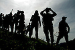 Colombian soldiers stand guard while they clean the area of explosive devices placed by guerrilla groups and criminal gangs. during a coca plant eradication program at the Antioquia mountains In Colombia so far this year have been eradicated 900 hectares in the country, mainly in rural areas, there are about 2,500 men engaged in this work. According to the Presidential Program for Comprehensive Action against Antipersonnel Mines, between 1990 and January 31, 2012, have been affected by landmines l9.642 people, of these, 674 were injured in eradication. Medellín, July 3 of 2012. Photo by Fredy Amariles/ VIEWpress.