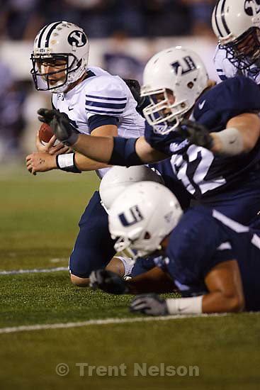 Logan - BYU vs. Utah State University (USU) college football Friday, October 3, 2008. BYU quarterback Max Hall (15) is sacked by Utah State DE Ben Calderwood in the fourth quarter. Fist sack allowed by BYU all season.