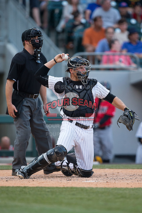 Charlotte Knights catcher Kevan Smith (32) throws the ball back to his pitcher during the game against the Indianapolis Indians at BB&T BallPark on June 20, 2015 in Charlotte, North Carolina.  The Knights defeated the Indians 6-5 in 12 innings.  (Brian Westerholt/Four Seam Images)