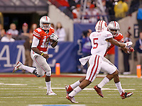 Ohio State Buckeyes quarterback Cardale Jones (12) runs in the third quarter of the Big Ten Championship game at Lucas Oil Stadium in Indianapolis on Saturday, December 6, 2014. (Columbus Dispatch photo by Jonathan Quilter)