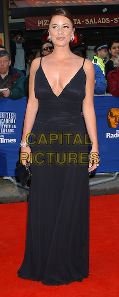 TAMZIN OUTHWAITE.The British Academy Television Awards, Leicester Square, London..13 April 2003.full length, full-length, long black dress, plunging neckline, cleavage.www.capitalpictures.com.sales@capitalpictures.com.©Capital Pictures