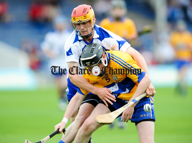 Enda Boyce of  Clare in action against Eamonn Murphyof Waterford during their Munster minor final at Thurles. Photograph by John Kelly.