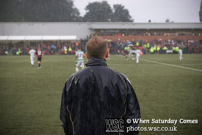 The New Saints 4 Bohemians 0, 20/07/2010. Park Hall Stadium, Champions League 2nd qualifying round 2nd leg. The New Saints manager Mike Davies watching the action through the rain at Park Hall Stadium, Oswestry during his team's Champions League 2nd qualifying round 2nd leg game with visitors Bohemians. Despite leading 1-0 from the first leg, the Dublin club went out following their 4-0 defeat by the Welsh champions. The match was the first-ever Champions League match in the UK played on an artificial pitch and was staged at the Welsh Premier League's ground which was located over the border in England. Photo by Colin McPherson.