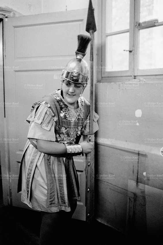 Switzerland. Canton Ticino. Mendrisio. A young boy, dressed up as a roman soldier, holds a spear in his hand. The teenager is getting ready for the historical and religious Good Friday processions. © 2001 Didier Ruef