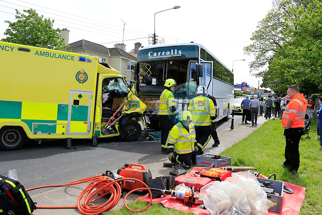 the scene of an accident between an ambulance and a school bus on the Ballymakenny road in Drogheda Co Louth. the Ambulance which had been stolen a short time earlier crashed head on into the school bus which was on its way to collect children from one of the local schools. the driver had to be cut from the ambulance by fire service using cutting equipment before being transferred to Our Lady of Lourdes hospital where the ambulance he was driving had been stolen from and crashing throughout eh security barriers.<br /> Picture: www.newsfile.ie