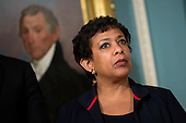 United States Attorney General Loretta Lynch looks on as US President Barack Obama makes a statement after meeting with his National Security Council at the State Department, February 25, 2016 in Washington, DC. The meeting focused on the situation with ISIS and Syria, along with other regional issues. <br /> Credit: Drew Angerer / Pool via CNP