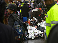December 7, 2011  (Washington, DC)  OccupuDC protesters sit and block K Street on a day chilled with winter rain.  Dozens of protesters were arrested after refusing to obey police orders to clear the street.   (Photo by Don Baxter/Media Images International)