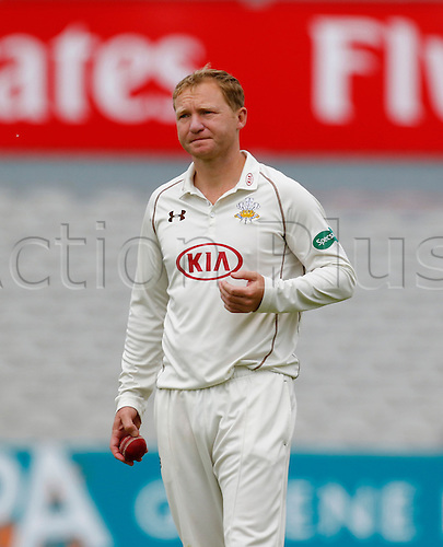 23.05.2016. Old Trafford, Manchester, England. Supersavers County Championship. Lancashire versus Surrey. Surrey captain, all-rounder Gareth Batty looks on as Lancashire pass his side's 1st innings total of 191.