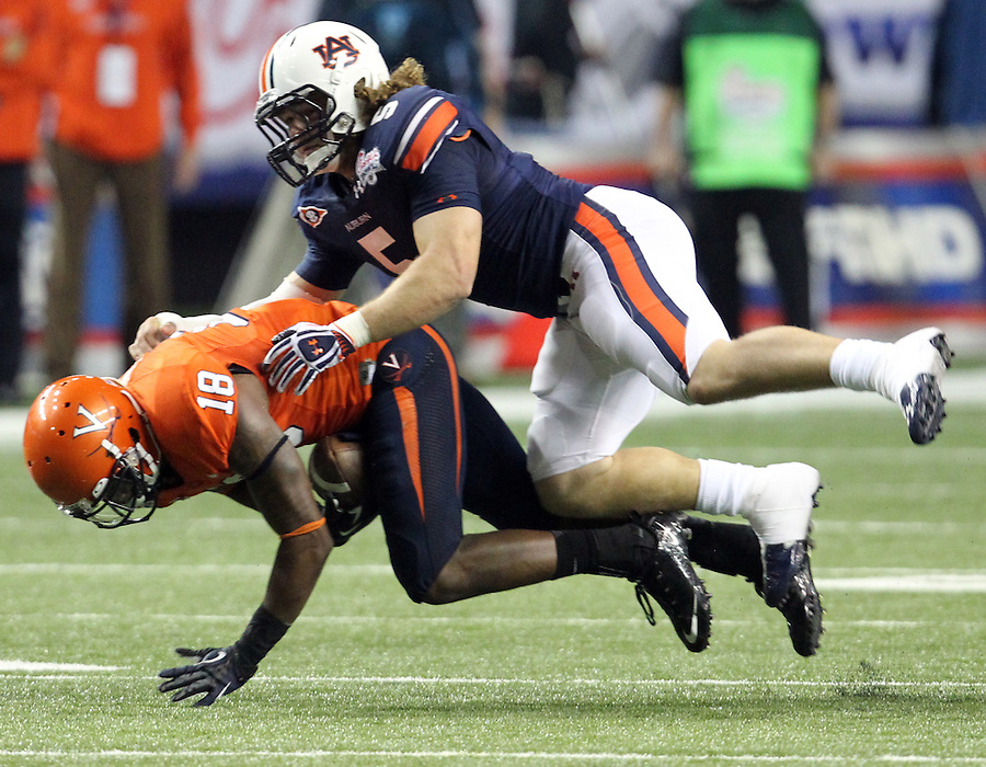 ATLANTA, GA - DECEMBER 31: Jake Holland #5 of the Auburn Tigers tackles Kris Burd #18 of the Virginia Cavaliers during the 2011 Chick Fil-A Bowl at the Georgia Dome on December 31, 2011 in Atlanta, Georgia. Auburn defeated Virginia 43-24. (Photo by Andrew Shurtleff/Getty Images) *** Local Caption *** Kris Burd;Jake Holland