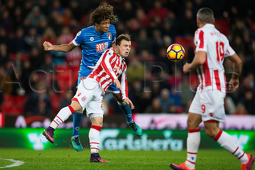 19.11.2016. Bet365 Stadium, Stoke, England. Premier League Football. Stoke City versus AFC Bournemouth. Stoke City midfielder Xherdan Shaqiri and Bournemouth defender Nathan Ake fight for the ball.