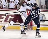 Patrick Brown (BC - 23), Brett Pesce (UNH - 22) - The Boston College Eagles defeated the visiting University of New Hampshire Wildcats 5-2 on Friday, January 11, 2013, at Kelley Rink in Conte Forum in Chestnut Hill, Massachusetts.