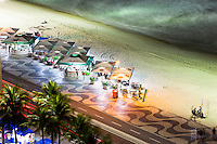 Stylized and standardized Kiosks with restaurants and bars at Copacabana beach sidewalk - view from above of Copacabana promenade, a pavement landscape in large scale ( 4 kilometres long ) having a black and white Portuguese pavement design  by Roberto Burle Marx, a geometric wave. Rio de Janeiro, Brazil.