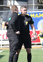 4th Official Steven Kirkland (left) having words with Referee Greg Aitken in the SPFL Ladbrokes Championship Play Off semi final match between Queen of the South and Montrose at Palmerston Park, Dumfries on  11.5.19.