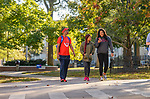 A group of friends keeps up to date while walking across the Circle. Photo by Robert Jordan/Ole Miss Communications