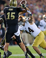 Linebacker Carlo Calabrese (44) gets pressure on Purdue Boilermakers quarterback Rob Henry (15) in the third quarter.