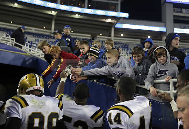 Young fans greet Alabama State players after the University of Kentucky Homecoming football game against Alabama State at Commonwealth Stadium in Lexington, Ky., on Saturday, November 2, 2013. Photo by Emily Wuetcher | Staff