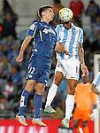 Getafe's Stefan Scepovic (l) and Malaga's Marcos Alberto Angeleri during La Liga match.September 18,2015. (ALTERPHOTOS/Acero)