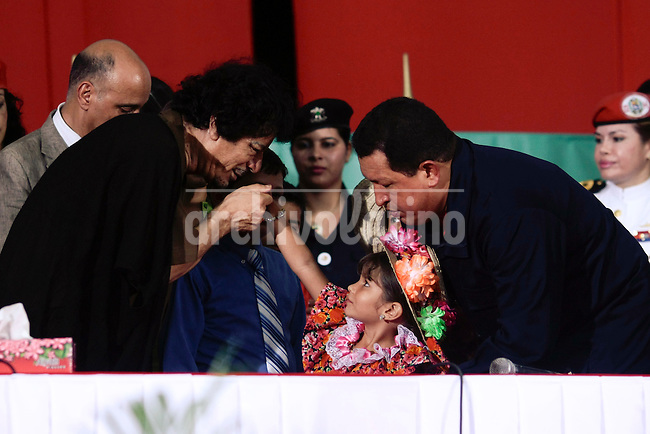 Venezuela's President Hugo Chavez,and  Libya's President Moammar Gadhafi during a meeting in Porlamar, Margarita Island, Venezuela, Monday, Sept. 28, 2009.
