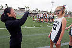 San Diego, CA 05/21/11 - A referee checks a stick of the Coronado's players.