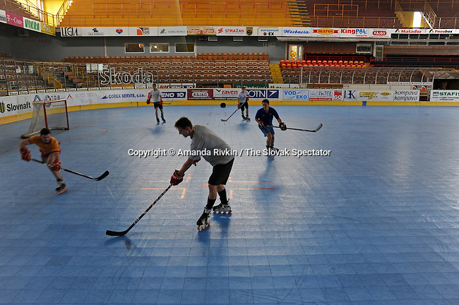 Young men play indoor inline skating hockey in the Dukla Trencin stadium in Trencin, Slovakia on June 21, 2010.  The Dukla Trencin ice hockey team is among Slovakia's most successful and has sent at least 24 players to America's National Hockey League (NHL).