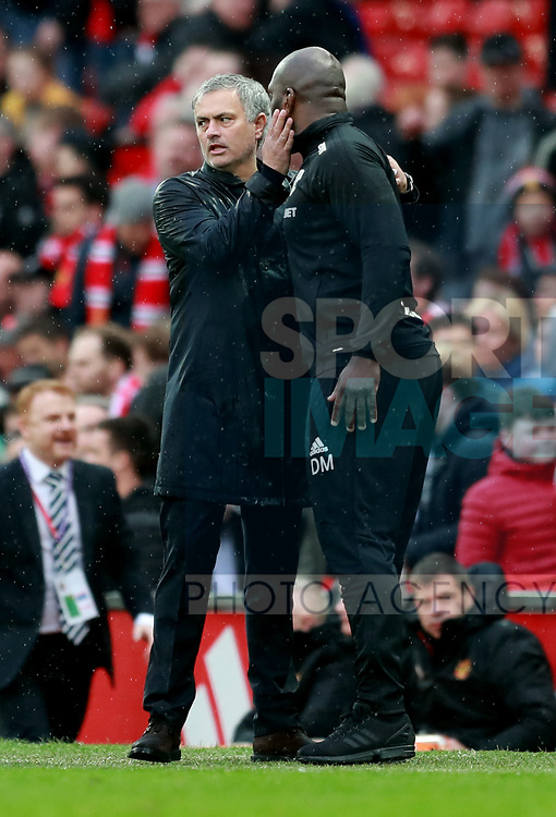 Jose Mourinho manager of Manchester United congratulates West Brom stand in manager Darren Ward during the premier league match at the Old Trafford Stadium, Manchester. Picture date 15th April 2018. Picture credit should read: Simon Bellis/Sportimage
