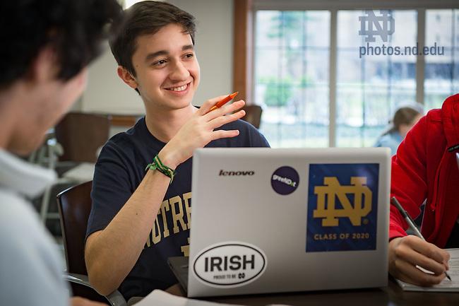 March 9, 2017; Pedro Navarro '20, international student from Brazil, studies with fellow Brazilian undergraduates. (Photo by Matt Cashore/University of Notre Dame)