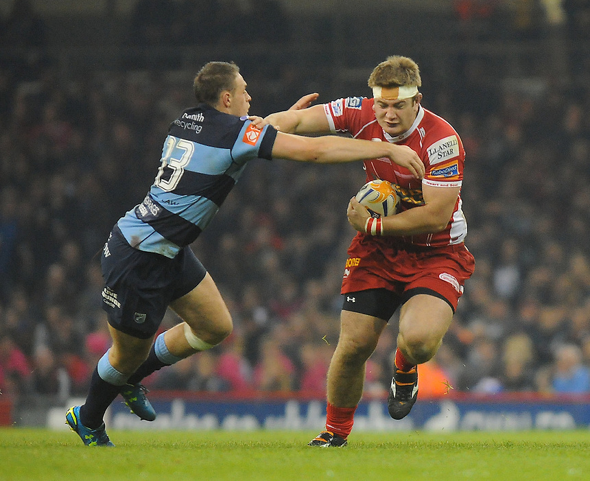 Scarlets' Rhodri Jones evades the tackle of Cardiff Blues' Cory Allen<br /> <br /> Photo by Kevin Barnes/CameraSport<br /> <br /> Rugby Union - Rabo Direct PRO 12 - Cardiff Blues v Scarlets - Sunday 20th April 2014 - The Millennium Stadium - Cardiff<br /> <br /> &copy; CameraSport - 43 Linden Ave. Countesthorpe. Leicester. England. LE8 5PG - Tel: +44 (0) 116 277 4147 - admin@camerasport.com - www.camerasport.com