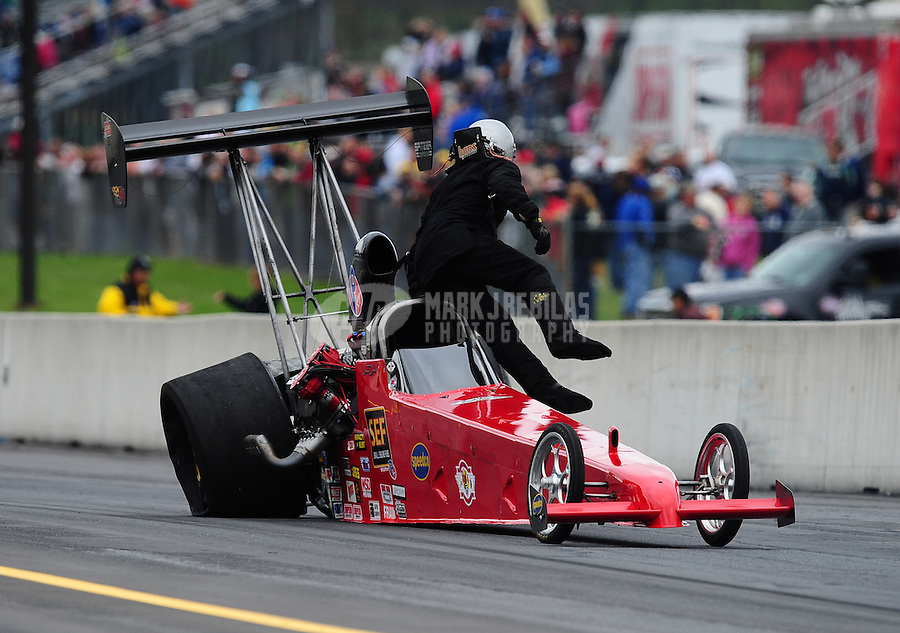 Oct. 1, 2011; Mohnton, PA, USA: NHRA top alcohol dragster driver Jared Dreher climbs from his car after getting a flat tire during qualifying for the Auto Plus Nationals at Maple Grove Raceway. Mandatory Credit: Mark J. Rebilas-