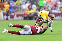 Landover, MD - September 23, 2018: Washington Redskins linebacker Preston Smith (94) makes a touchdown saving tackle against Green Bay Packers running back Aaron Jones (33) during game between the Green Bay Packers and the Washington Redskins at FedEx Field in Landover, MD. The Redskins get the win 31-17 over the visiting Packers. (Photo by Phillip Peters/Media Images International)