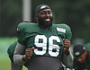 Mohammad Wilkerson #96 stretches during New York Jets Training Camp at the Atlantic Health Jets Training Center in Florham Park, NJ on Monday, Aug. 14, 2017.