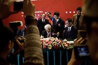 People photograph Bishop K. H. Ting as he signs the 50 millionth Bible produced by the Amity Printing Company in Nanjing, China. The Amity Printing Company is the only company allowed to publish Christian Bibles in China and, with a new printing facility scheduled to open in May 2008, is the world's largest producer of Bibles.  Bishop Ting helped found the Amity Foundation, the Christian charity that oversees the Amity Printing Company, in 1985 with the express purpose of promoting education, health, social welfare, and rural development in China.