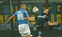 Gokhan Inler   Hernanes  during the Italian serie A   soccer match between SSC Napoli and Inter    at  the San Siro    stadium in Milan  Italy , Octobrr 19 , 2014