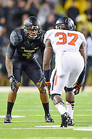Baylor wide receiver Jay Lee (4) and Oklahoma State cornerback Tyler Jaynes (37) during second half of an NCAA football game, Saturday, November 22, 2014 in Waco, Tex. Baylor defeated Oklahoma State 49-28. (Mo Khursheed/TFV Media via AP Images)