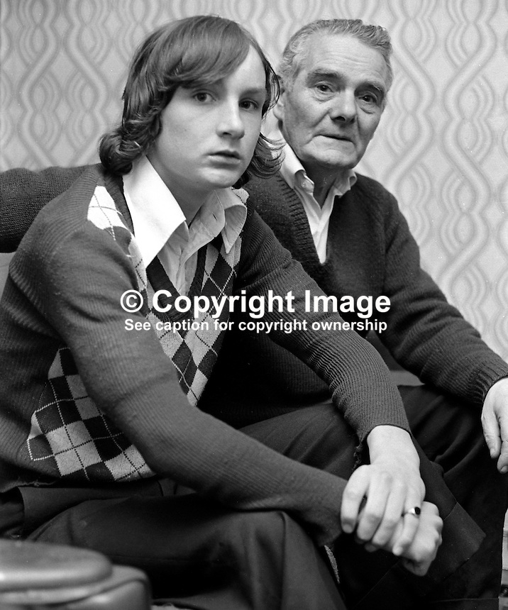 Christy O'Neill, husband, and Sean O'Neill, son, who were with Mrs Margaret O'Neill, from Maralin Street, who was killed when gunmen sprayed bullets at random as they drove along the New Lodge Road, Belfast, N Ireland, 14th June 1975. One other person was seriously injured. A passing British Army Parachute Regiment mobile patrol heard the shooting and gave chase halting it in the Tiger Bay area. In February 1976 four men from  the Woodvale Defence Association were given life sentences. 197506140485b..Copyright Image from Victor Patterson, 54 Dorchester Park, Belfast, UK, BT9 6RJ..Tel: +44 28 9066 1296.Mob: +44 7802 353836.Voicemail +44 20 8816 7153.Skype: victorpattersonbelfast.Email: victorpatterson@me.com.Email: victorpatterson@ireland.com (back-up)..IMPORTANT: If you wish to use this image or any other of my images please go to www.victorpatterson.com and click on the Terms & Conditions. Then contact me by email or phone with the reference number(s) of the image(s) concerned.