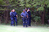 Clinton, MD - October 9, 2002 --  Prince Georges County Police, assisted by Federal Agents investigate a report of a man going into the woods carrying a black case in Clinton, MD on 8 October, 2002.  The woods are near an elementary school and a high school.<br /> Credit: Ron Sachs / CNP<br /> (RESTRICTION: NO New York or New Jersey Newspapers or newspapers within a 75 mile radius of New York City)