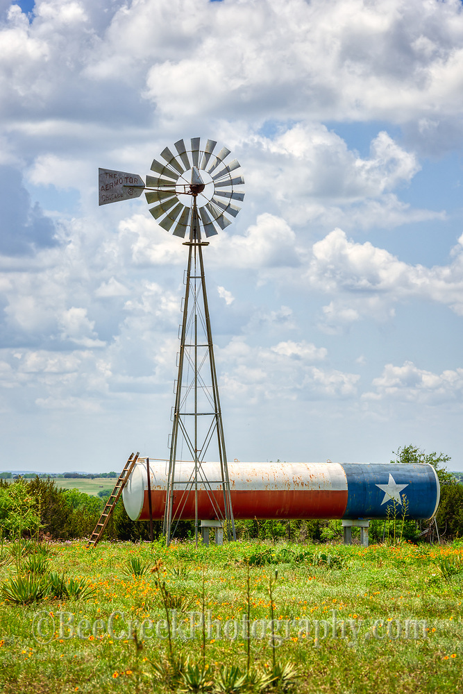 We came across this ranch with the Texas Flag painted on the propane tank in next to the windmill it just seem to say I am proud of Texas so we stopped and capture this photo on this day with the great clouds and sky.