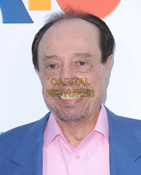 """SERGIO MENDES .at The Twentieth Century Fox and Blue Sky Studios L.A. Premiere of """"RIO"""" held at The Grauman's Chinese Theatre in Los Angeles, California, USA, .April 10th 2011..portrait headshot pink shirt blue stubble facial hair .CAP/RKE/DVS.©DVS/RockinExposures/Capital Pictures."""