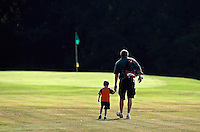 "Pat Raymark and his son Jack Raymark make their way down a fairway at Woodheaven Golf Club in Pendleton during a session of Little Legends golf. Raymark said that he had taken 5-year-old Jack out a few times this summer before starting him in the youth golf clinic. ""All I wanted was for him to enjoy it and have fun, and he has,"" he said."
