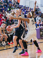 McNeil's Hannah Sunstrom looks to pass under pressure by Cedar Ridge's Aleisa McFarlin Saturday at Cedar Ridge.  The Mavs lost to the Raiders 84-39.  (LOURDES M SHOAF for Round Rock Leader.)