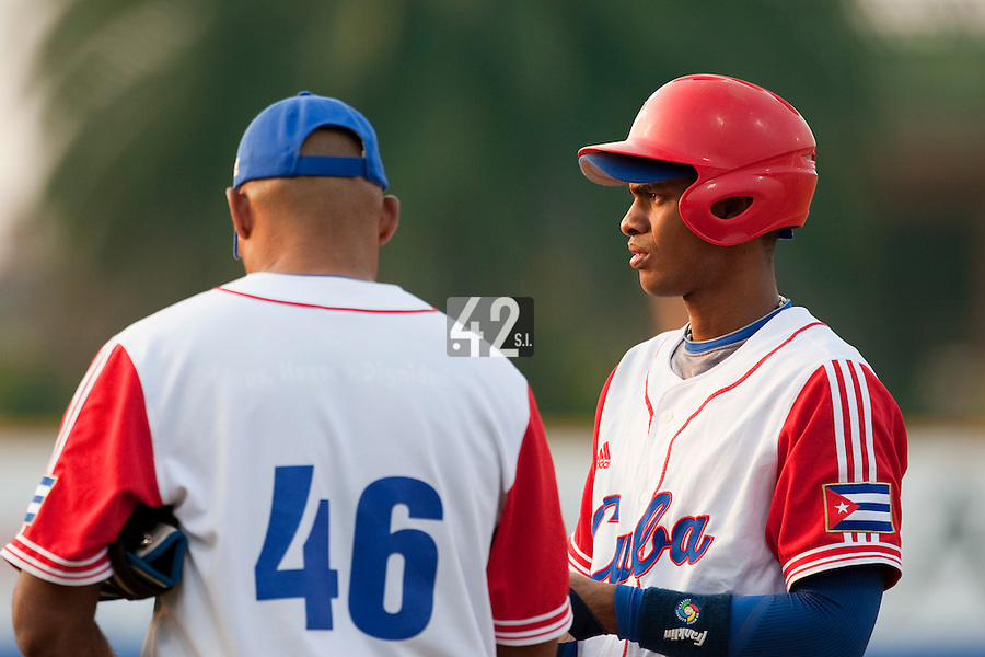 27 September 2009: Hector Olivera of Cuba stands next to first base coach Orestes Kindelan during the 2009 Baseball World Cup gold medal game won 10-5 by Team USA over Cuba, in Nettuno, Italy.