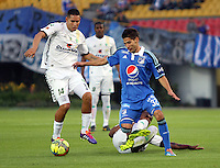 BOGOTA -COLOMBIA. 02-02-2014. Jhonatan Agudelo (Der) de Millonarios  disputa el balon contra Jhon Valencia de La Equidad durante el partido por la segunda fecha de La liga Postobon 1 disputado en el estadio El Campin. / Jhonatan Agudelo (R) Millonarios fights for the ball against Jhon Valencia of  La Equidad  during the match for the second date of the Postobon one league match at El Campin  Stadium Photo: VizzorImage/ Felipe Caicedo / Staff