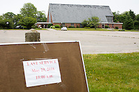 "A sign outside reads ""Last Service / May 29, 2016 / 10:00am"" at St. Frances Xavier Cabrini Church in Scituate, Mass., on Sun., May 29, 2016. Members of the congregation have been holding a vigil for more than 11 years after the Archdiocese of Boston ordered the parish closed in 2004. For 4234 days, at least one member of Friends of St. Frances X. Cabrini has been at the church at all times, preventing the closure of the church. May 29, 2016, was the last service held at the church after members finally agreed to leave the building after the US Supreme Court decided not to hear their appeal to earlier an Massachusetts court ruling stating that they must leave. The last service was called a ""transitional mass"" and was the first sanctioned mass performed at the church since the vigil began."