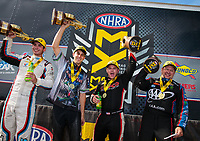 Oct 7, 2018; Ennis, TX, USA; (From left) NHRA pro stock driver Tanner Gray, pro stock motorcycle rider L.E. Tonglet, top fuel driver Steve Torrence and funny car driver Robert Hight celebrate after winning the Fall Nationals at the Texas Motorplex. Mandatory Credit: Mark J. Rebilas-USA TODAY Sports