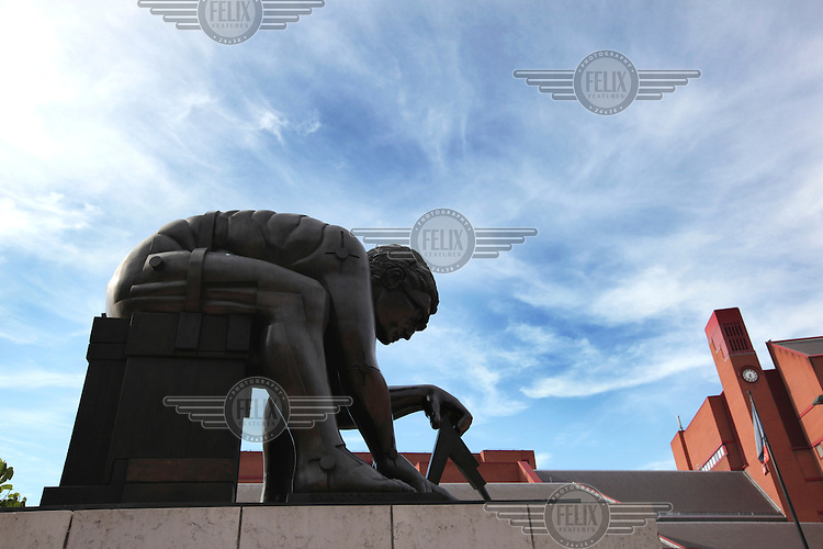 A statue of Isaac Newton by the sculptor Eduardo Paolozzi outside The British Library in London.